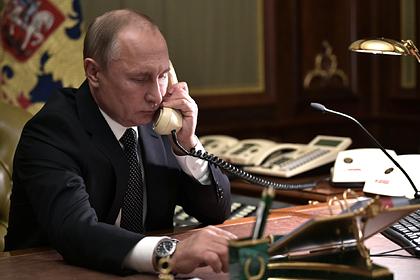 Путин обсудил с Меркель Украину